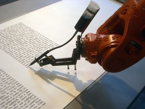 A writing robot. Lacks personality. <i>Credit: Mirko Tobias Schaefer, http://www.flickr.com/photos/gastev/2174504149/ </i>