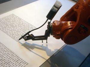 A writing robot. Lacks personality. <i>Credit: Mirko Tobias Schaefer, http://www.flickr.com/photos/gastev/2174504149/ </i>